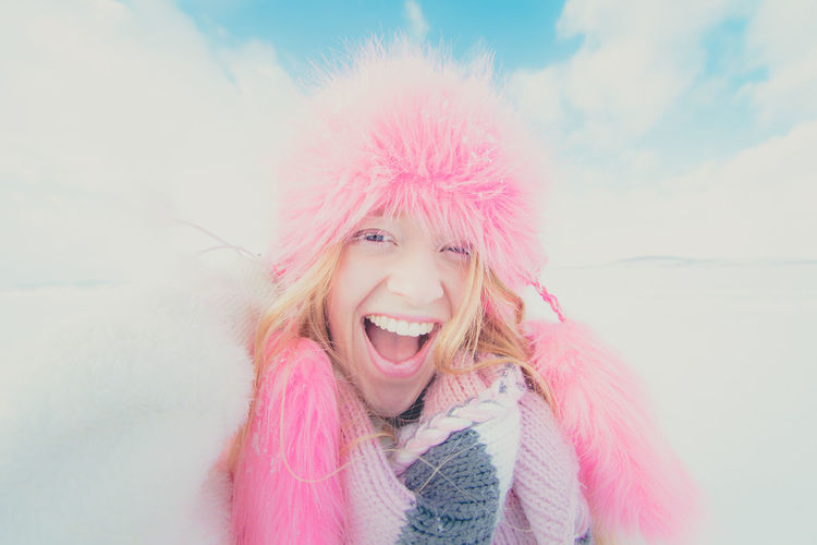 Portrait Of Young Woman With Pink Hat Against Sky