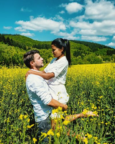 Summer Germany Yellow Flower Saint Lucia St Lucia Man Bonding Togetherness Women Happiness Men Young Women Love Field Care Embracing Sunflower Cultivated Land Sepal Farmland Crop  Pollen Agricultural Field Growing Plantation Cereal Plant Blooming Oilseed Rape Single Parent Flower Head