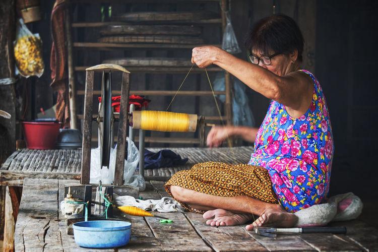 Woman working on loom
