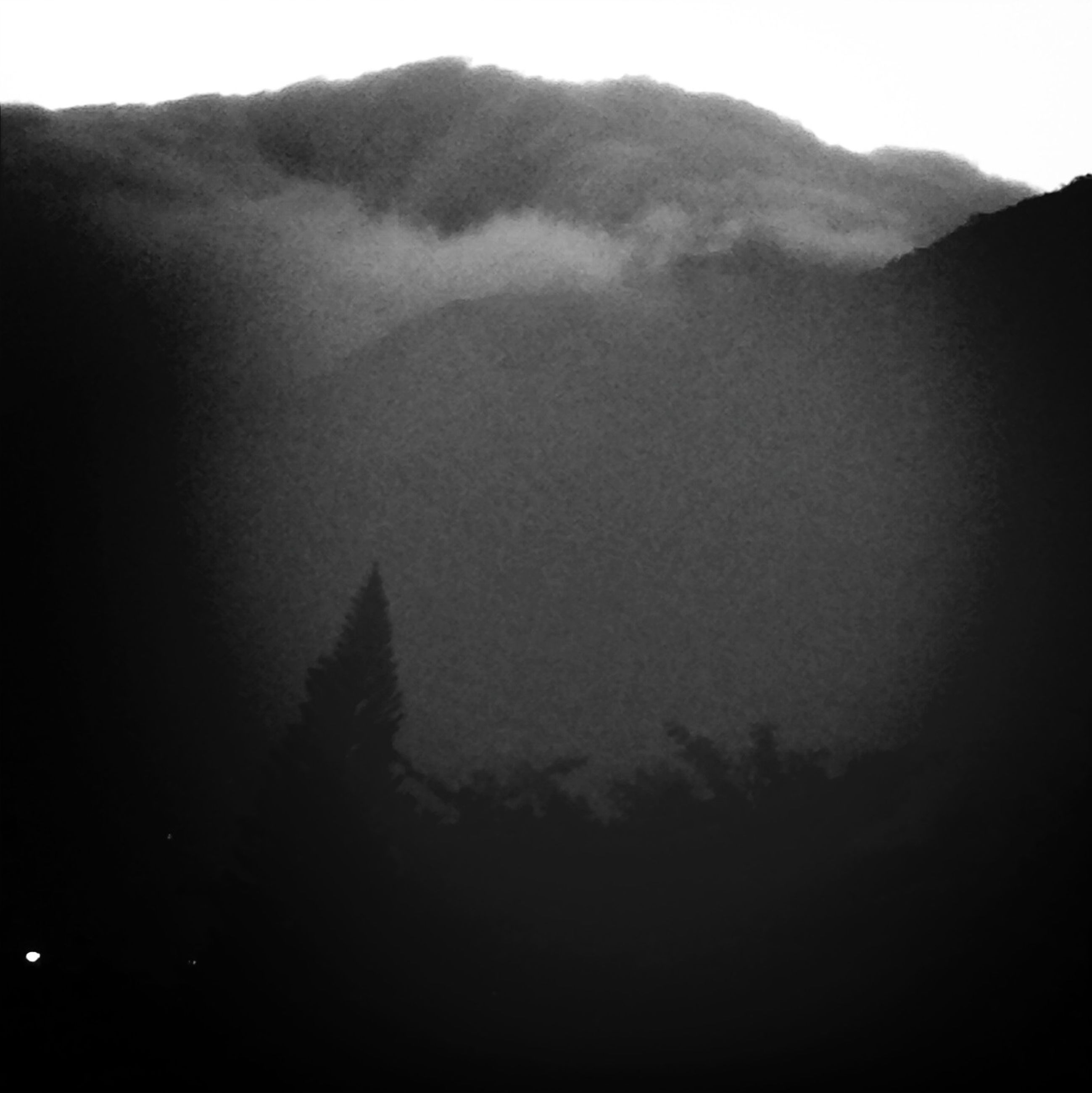 mountain, tranquil scene, tranquility, scenics, mountain range, beauty in nature, fog, landscape, nature, silhouette, sky, tree, idyllic, non-urban scene, foggy, outdoors, remote, dusk, no people, dark