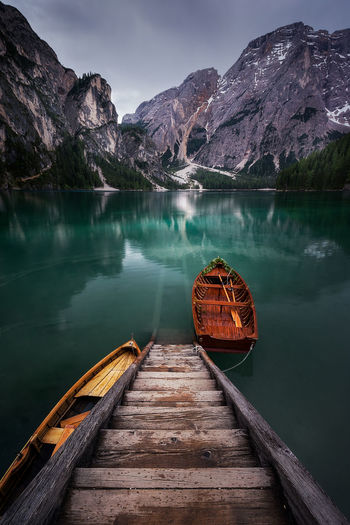 Lake Reflection Reflections In The Water No People Tranquility Wood - Material Beauty In Nature Water Mountain Scenics - Nature Sky Nautical Vessel Transportation Mountain Range Turquoise Colored Non-urban Scene Tranquil Scene Nature Outdoors Idyllic Italy Braies Lake Braies Lake Dolomites Boat Shipping