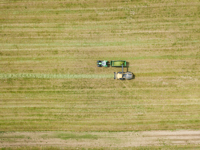 Agricultural Equipment Agricultural Machinery Agriculture Day Environment Field Grass Green Color Land Land Vehicle Landscape Mode Of Transportation Motor Vehicle Nature No People Outdoors Plant Prairie Rural Scene Scenics - Nature Tractor Transportation