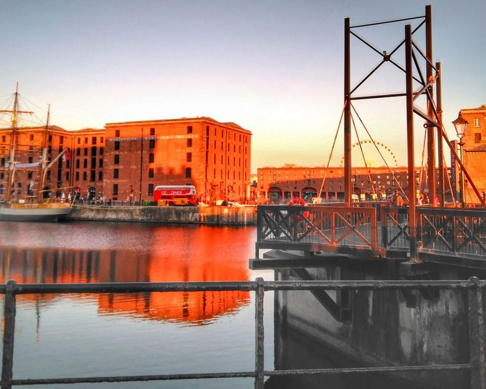 Albert dock under an orange sunset Architecture Built Structure Water Sky Building Exterior City Reflection Sunset Outdoors Bridge Orange Color