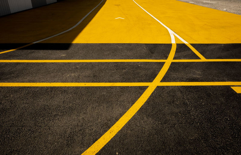 Road markings in an industrial area of Bordeaux, France. Architecture Asphalt Bordeaux City France Graphic Lines Travel Travel Photography Black Daylight Design Fujifilm Fujifilm_xseries Geometry History Minimal Minimalism No People Road Marking Street Street Photography Streetphotography Sun Yellow