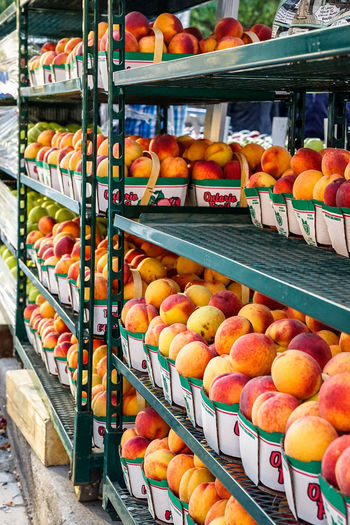 summer peaches of Ontario Fruit Peaches Supermarket City Price Tag Store Retail  Shelf In A Row Fruit Sweet Food Food And Drink For Sale Display Farmer Market Retail Display Market