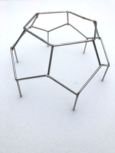 High angle view of metallic structure against white background