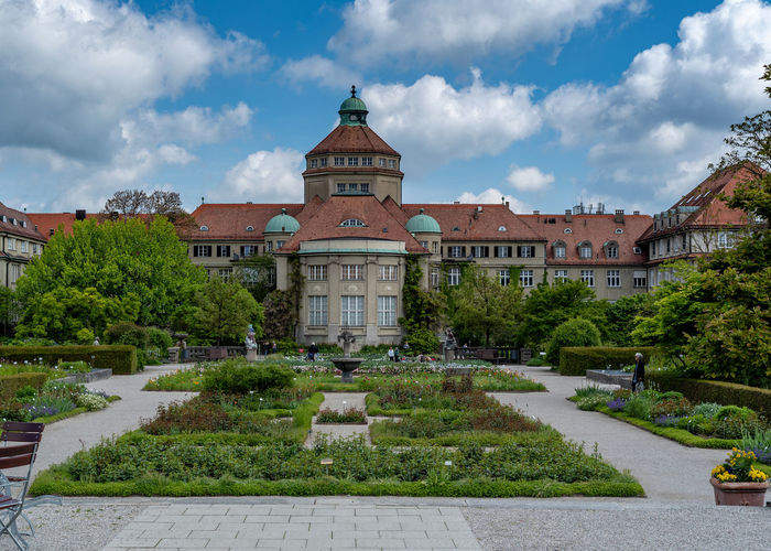 Munich, Bavaria, Germany - May 23, 2019. München-Nymphenburg Botanical garden on a spring day featuring the main building and the garden Menzinger Arboreturm Garden Munich Botanical Germany Building Bavaria Green Park Tourism Landmark Botany Nature Vegetation Plant Landscape Seasonal Historic Flowers Spring Season  Outdoors Scene Flora Leaves Trees Attraction Popular Lush Natural Colorful Bright Floral View Sunny Blossom Peaceful Vivid Panorama Pond Staatssammlung München State Collection Editorial  Formal Garden No People Building Exterior Built Structure