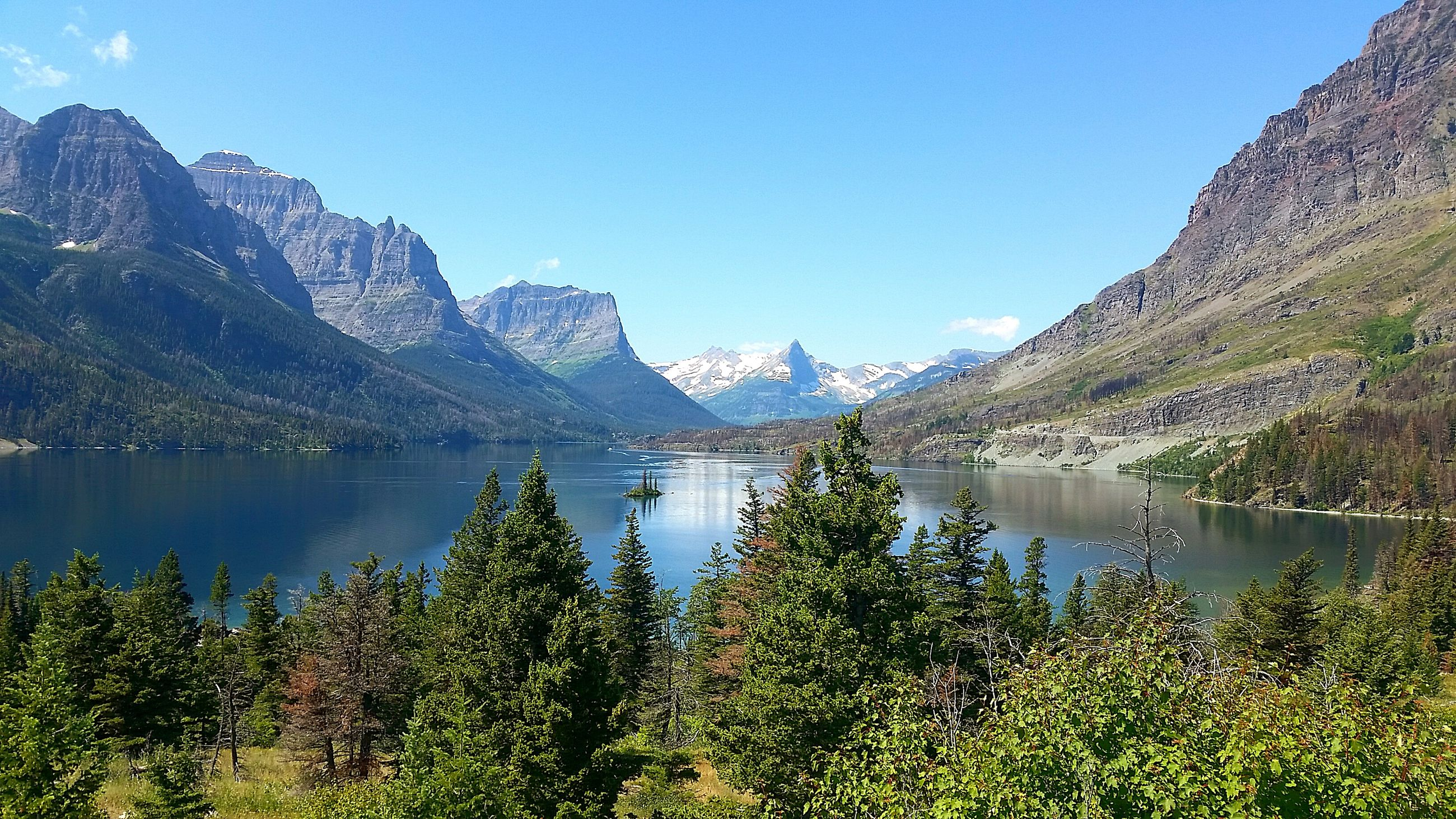 mountain, water, tranquil scene, lake, tranquility, beauty in nature, scenics, blue, mountain range, nature, tree, sky, idyllic, plant, growth, landscape, non-urban scene, day, season, outdoors, no people, majestic, remote, non urban scene, calm, tourism