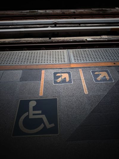 High angle view of wheelchair access sign at railroad station