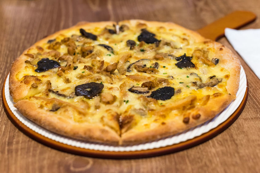 pizza Food And Drink Food Freshness Pizza Table Close-up Ready-to-eat Cheese Wood - Material Indoors  Dairy Product No People Vegetable Still Life Plate Italian Food Healthy Eating Selective Focus High Angle View Vegetarian Food Wood Grain
