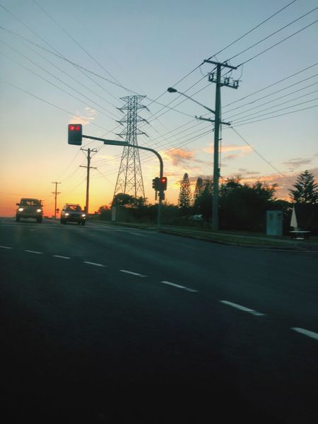 Early bird Sky Technology Electricity  Road Transportation Cable Power Line  Sunset Street Mode Of Transportation Sign City Motor Vehicle EyeEmNewHere EyeEmNewHere