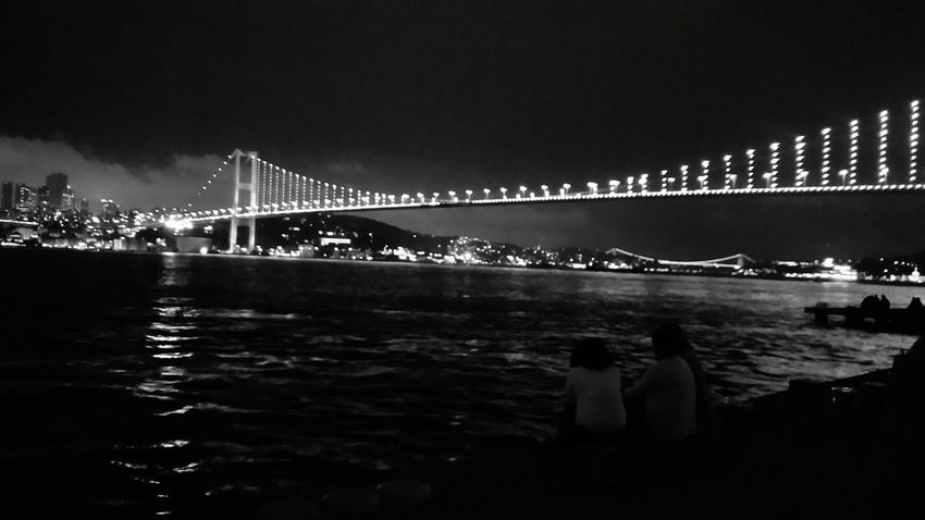 City Illuminated Suspension Bridge Bridge - Man Made Structure Beach Sea Sky Architecture