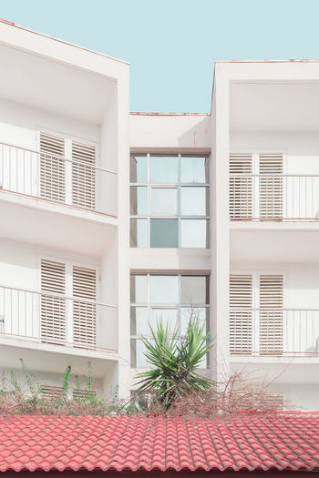 Architecture_collection Pastel Power Reflection Urban Geometry Abandoned Apartment Archidaily Architecture Balcony Building Exterior Built Structure Clear Sky Day Hotel No People Outdoors Pastel Residential Building Sky Summer Symmetry Urban Decay Urban Symmetry Window