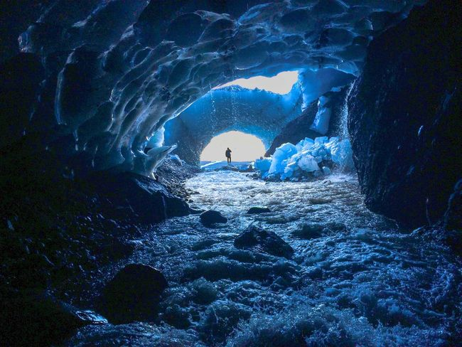 Exploring Ice Cave Adventure Adventure Time Beauty In Nature Cave Cold Temperature Day Daydreaming Exploration Full Length Looking At The Horizon Men Nature On The Edge One Person Power In Nature Real People Rock - Object Rock Formation Shiluette Silhouette Water Waterfall Winter
