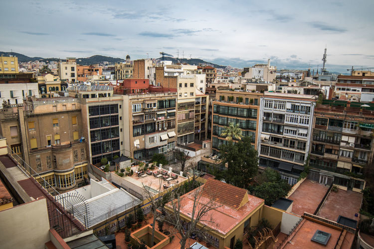 City Business Finance And Industry Cityscape Urban Skyline Roof Outdoors No People Architecture Day Portrait Of A City Edificios Aerial View Roof Travel Destinations Barcelona Turismo Street Photography Cityscape Skyline Turistic Places Vista Ciudad España Barrio Sky And Clouds