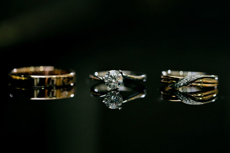 Wedding rings on black background Jewelry Ring Studio Shot Indoors  Diamond - Gemstone Close-up Diamond Ring No People Still Life Black Background Metal Engagement Ring Wealth Positive Emotion Wedding Ring Love Copy Space Gold Colored Gold Reflection Luxury Personal Accessory Platinum Precious Gem