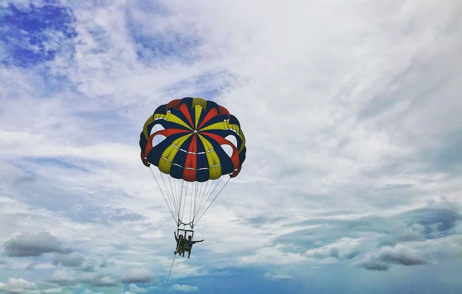 Parasailing. Eyemtravel Cloud - Sky Low Angle View Mid-air Sky Parachute Adventure Multi Colored Extreme Sports Paragliding Flying Outdoors