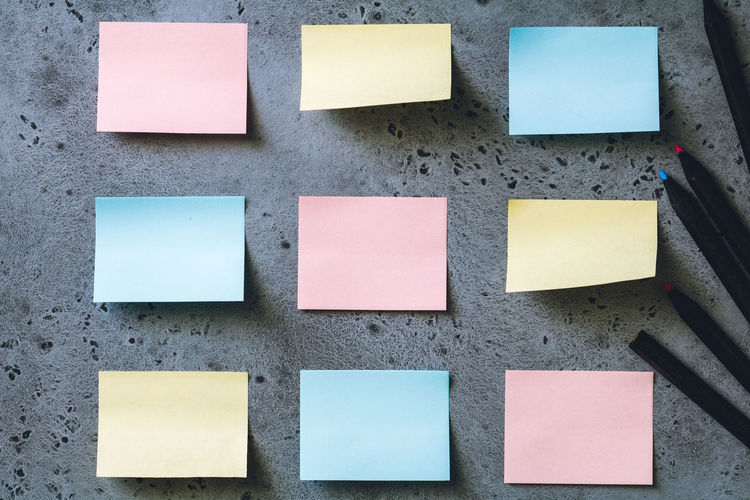 Close-up of blank adhesive notes on wall