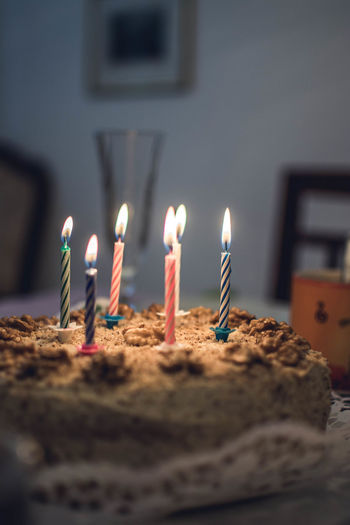View of candles on cake
