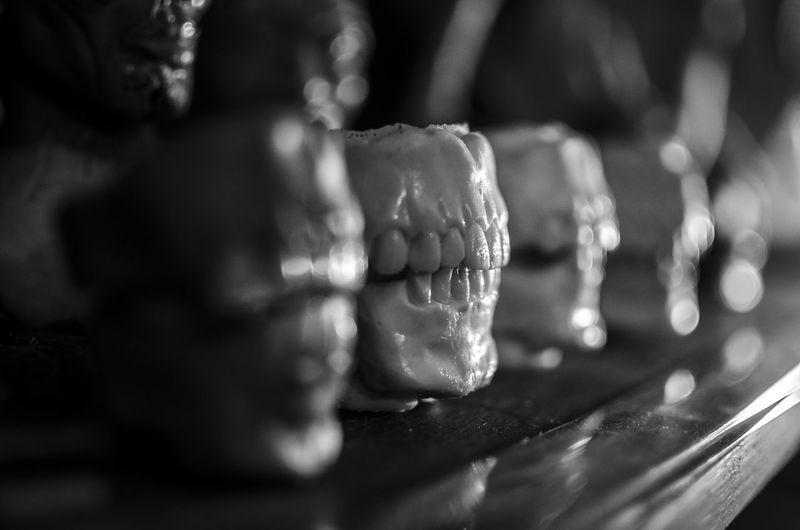 Close-up of dentures on shelf