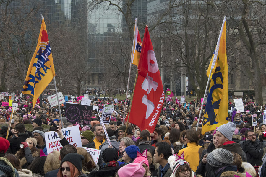 Union flags. Women's Solidarity March in Toronto, Canada. January 21, 2017 marked the history of the capital city of Ontario with one of the largest protest march gathering more than 60,000 people. Women were claiming more social justice and protesting many of Donald Trump stances. Anti-trump Canada Canadian Demanding  Democracy Freedom Girls Leftist March Movement Ontario People Power Revolution Signs Social Justice Symbols Toronto Toronto Canada Women's March Women's Solidarity March