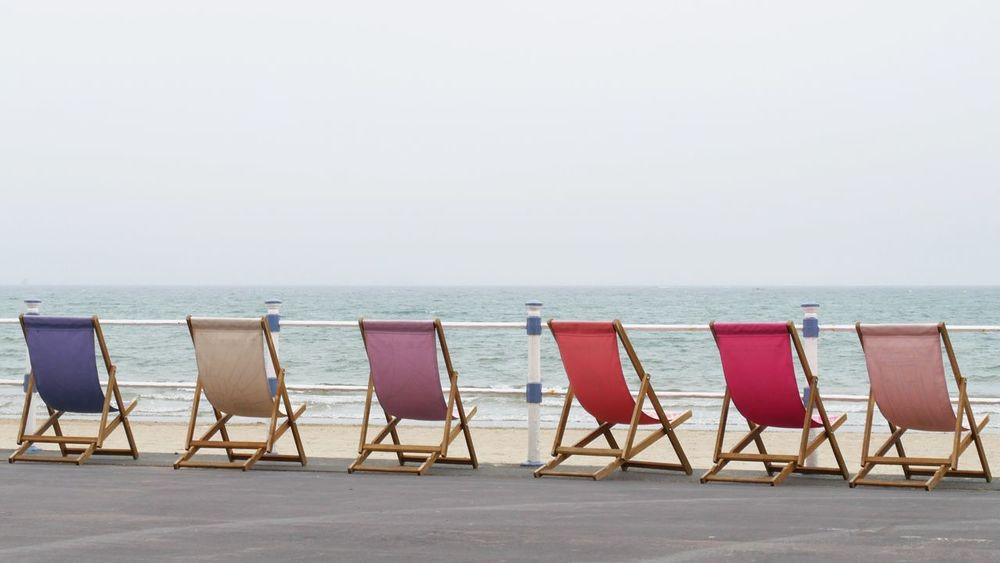 Colourful Empty Deck Chairs at the Seafront Boardwalk of Weymouth Dorset England United Kingdom No People Sea Seaside Seaside_collection Summer Seascape Sea And Sky Landscape The Essence Of Summer Global Photographers Alliance Global Photographer Works Exhibition Seascape Photography The Great Outdoors - 2016 EyeEm Awards Showcase June Fine Art Photography Colour Of Life