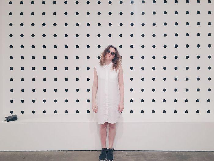 Portrait of woman standing indoors