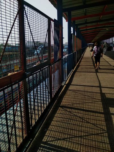 WALK THROUGH Phonography  Raw Candid Photowalk Lost Imperfection Profound Random Mesmerized Full Length City Bridge - Man Made Structure Walking Sky Architecture Built Structure Railroad Track Footbridge Diminishing Perspective Elevated Walkway Covered Bridge Empty Road EyeEmNewHere