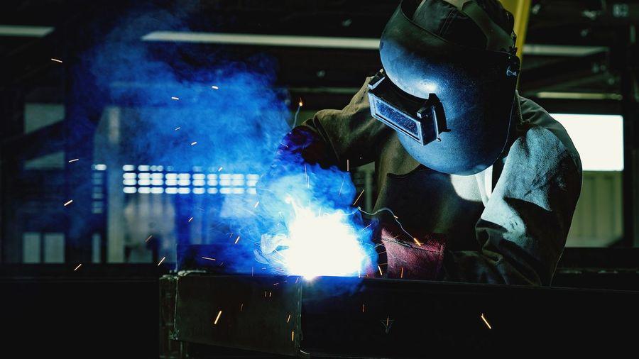 Man Welding At Factory