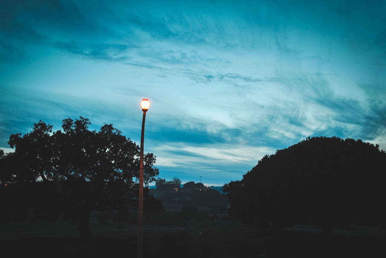 sky, cloud - sky, tree, silhouette, dusk, no people, outdoors, sunset, blue, low angle view, nature, beauty in nature, day