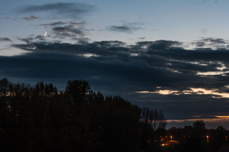 Croissant || Sky Cloud - Sky Tranquility Beauty In Nature Outdoors Landscape Night Tree Area No People Lights Light And Shadow Orléans France Travel Destinations Sunset And Clouds  Dusk Colours Astronomy Moon Tree Shadow Nature Long Exposure Night Lights