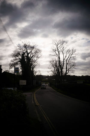 Cloudy weather on a day trip Atmospheric Mood Bare Tree Bare Trees Car Cloud Cloud And Sky Clouds And Sky Country Road Light Nature Nature_collection No People On The Road Outdoors Road Silhouette Sky Transportation Travel Traveling Tree
