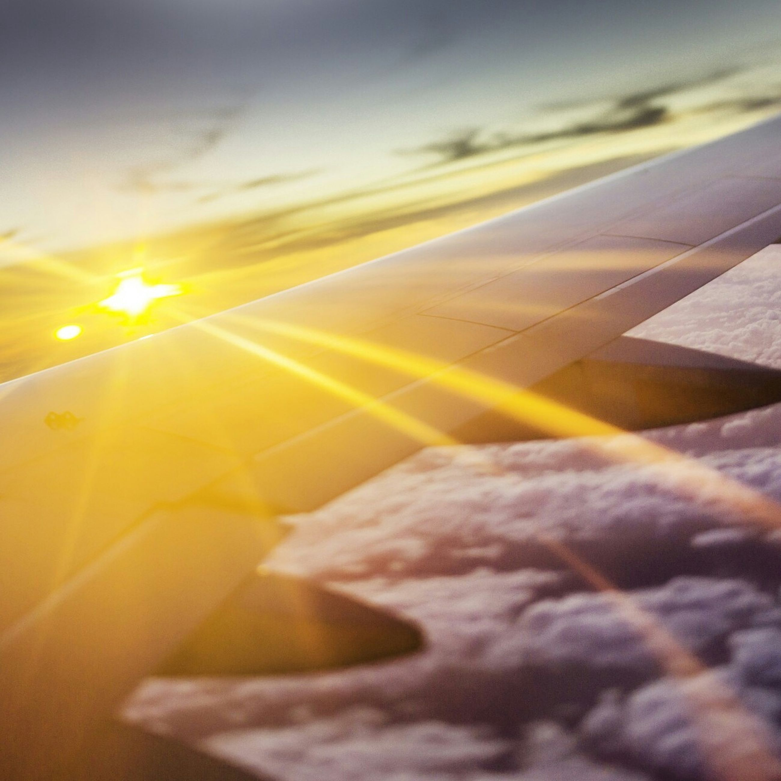yellow, transportation, sunset, close-up, no people, sky, part of, selective focus, cropped, sunlight, high angle view, outdoors, nature, orange color, cloud - sky, day, tilt, lens flare, airplane