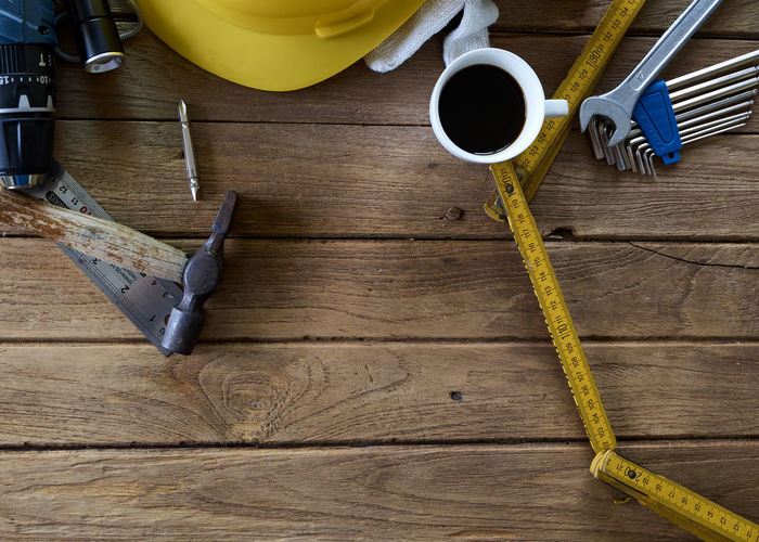 Close-up of coffee with various work tools on table