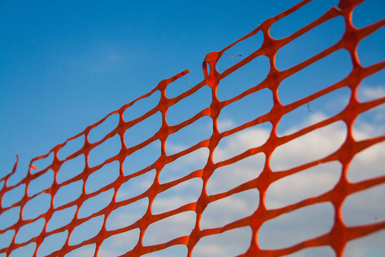 Low Angle View Of Plastic Grate Against Sky