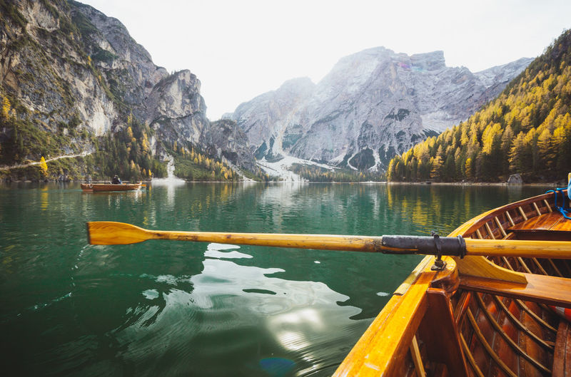 Scenic view of lake and mountains seen through boat