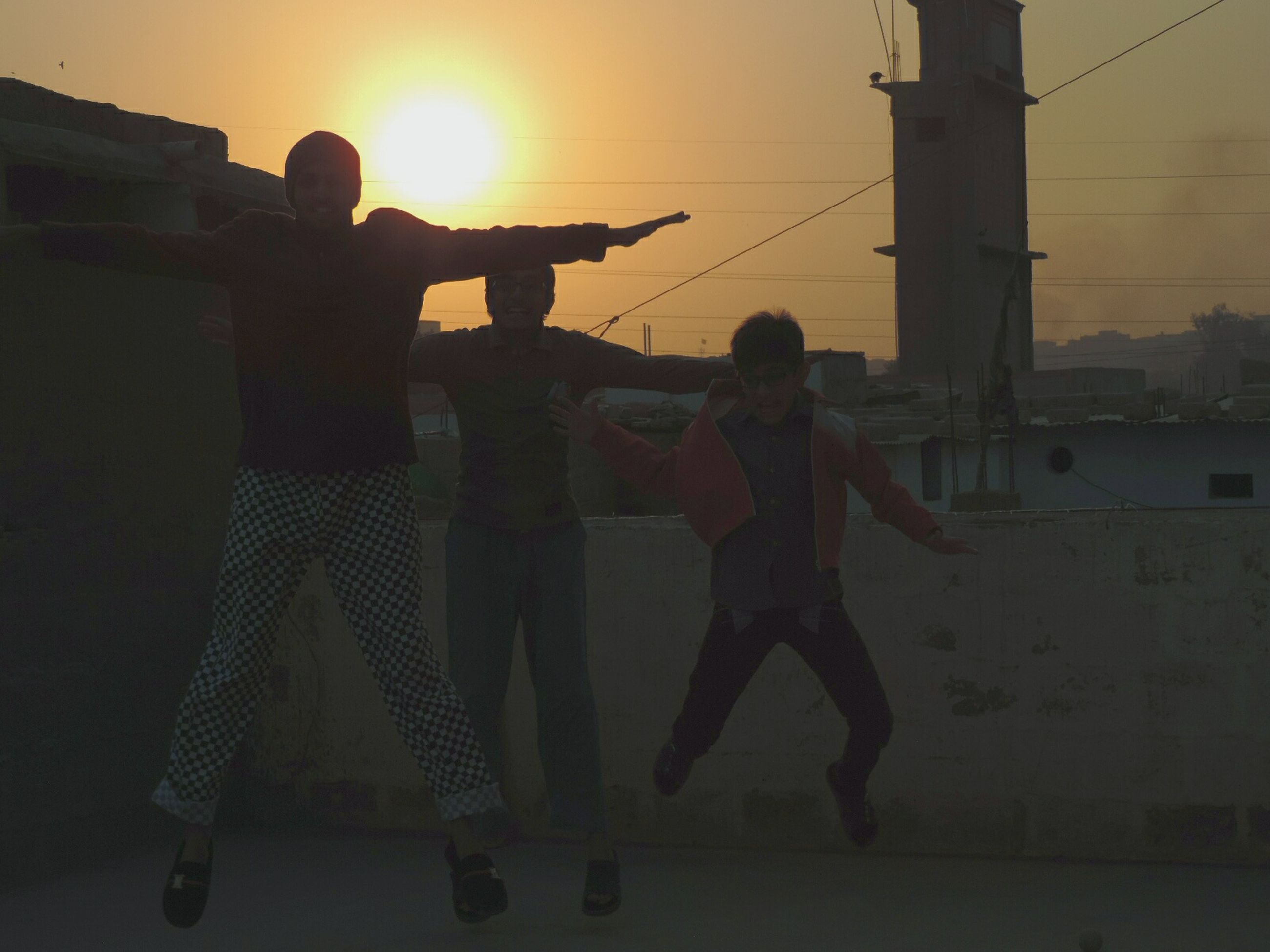 lifestyles, men, leisure activity, togetherness, bonding, silhouette, full length, sunset, person, sun, friendship, sunlight, love, standing, casual clothing, occupation