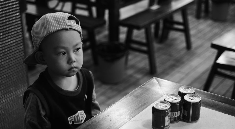 High angle portrait of boy sitting on table