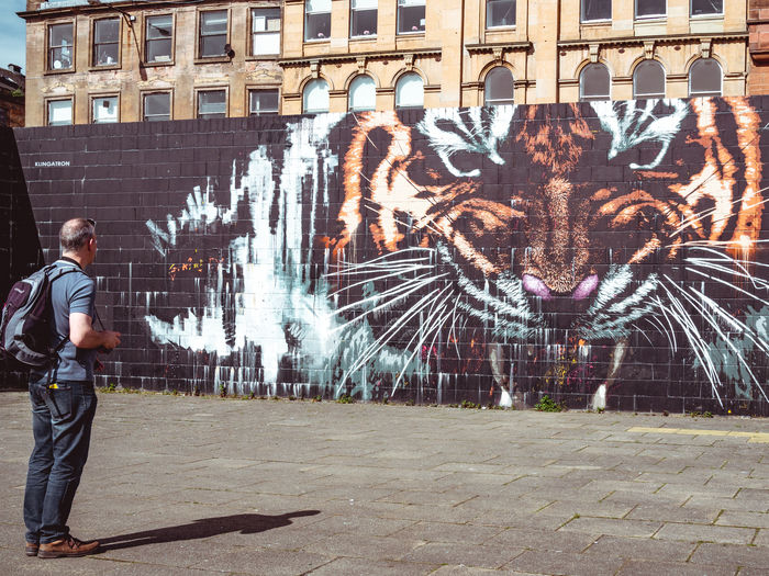 Urban Jungle Sightseeing GLASGOW CITY Graffiti Scotland Architecture Art And Craft Building Exterior Built Structure Casual Clothing City Creativity Day Full Length Leisure Activity Men One Person Outdoors Photographer Real People Standing Street Art Streetphotography