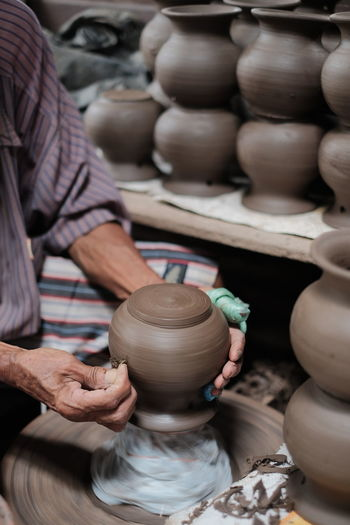 Backgrounds EyeEm Selects Human Hand Working Shoemaker Workshop City Occupation Men Craftsperson Clay Earthenware Mud Soil Spinning Pitcher - Jug Craft Product Muddy