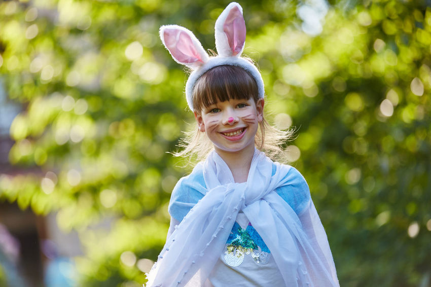 portrait of a smiling girl Bangs Bunny  Carnival Celebration Cheerfulness Child Childhood Circus Content Costume Creativity Day Dress Up Emotion Face Face Paint Face Painting Fantasy Focus On Foreground Front View Fun Funny Girl Girls Hairstyle Happiness Happy Hare Ears Headband Innocence Joyful Laughing Leisure Activity Lifestyles Looking At Camera Make Up One Person Outdoors People Play Portrait Positive Emotion Rabbit Real People Smile Smiling Theater Women
