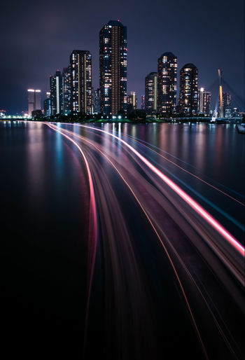Light trails in illuminated city at night