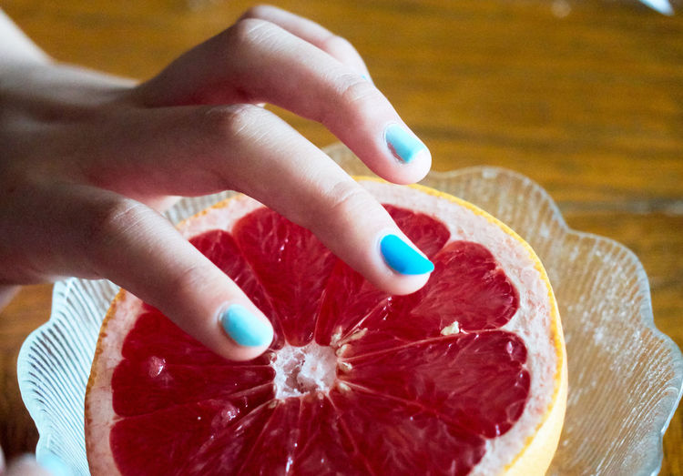 Body Part Close Up Close-up Colorful Finger Fingernail Fingers Food Food And Drink Freshness Grapefuit Hand Holding Human Body Part Human Finger Human Hand Indoors  Lifestyles One Person Preparation  Real People Red Temptation Unrecognizable Person Women