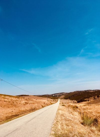 Old road in south of Portugal Alentejo,Portugal Portugal Road Sky Transportation Direction Blue The Way Forward Environment Landscape Diminishing Perspective Nature Tranquil Scene Empty Road Scenics - Nature Cloud - Sky