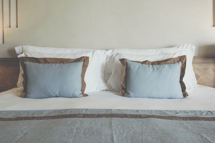 View of empty bed at home