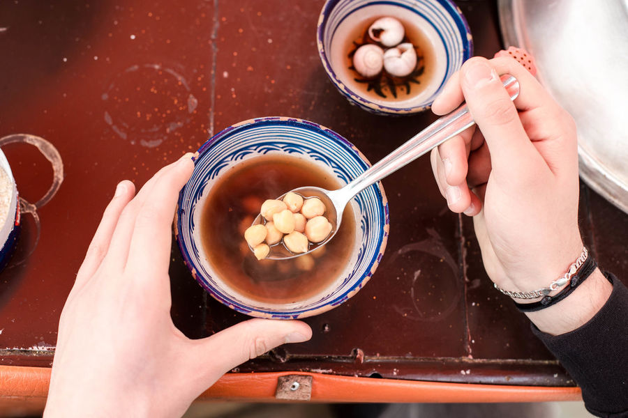Eating Hands Humous Snail Animals Bowl Bowls Close-up Day Dumpling  Food Food And Drink Freshness Holding Human Body Part Human Hand Hummus Indoors  Lifestyles One Person People Ready-to-eat Real People Salty Food Traditionnal Food