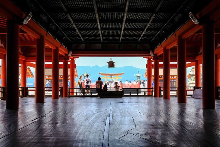 People praying at itsukushima shrine