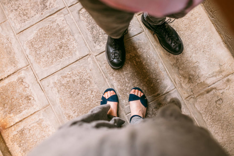 Venice Low Section Shoe Human Body Part Body Part Human Leg High Angle View Standing Two People Adult People Sandal Focus On Background Men Human Foot Day Selective Focus Directly Above Lifestyles Outdoors Personal Perspective Human Limb Tiled Floor