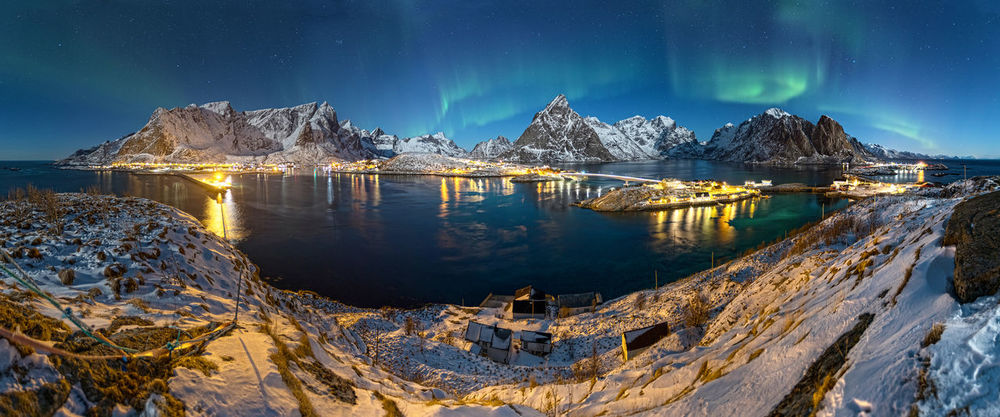 Sakrisøy panorama with Northern Lights Aurora Aurora Borealis Lady Aurora Northern Lights Norway Norway Lights Sakrisøy Beauty In Nature Cold Temperature Ice Landscape Lofoten Mountain Nature Night No People Panoramic Scenics - Nature Sky Snow Snowcapped Mountain Star - Space Tranquil Scene Water Winter