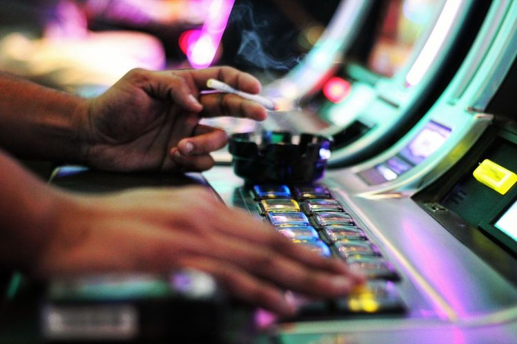 Human Hand Close-up Technology Illuminated Indoors  Casino Night Casino Smoking Slot Machine